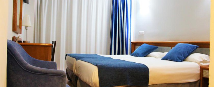 DOUBLE ROOM WITH EXTRA BED (2 ADULTS + 1 CHILD) in Marbel Hotel